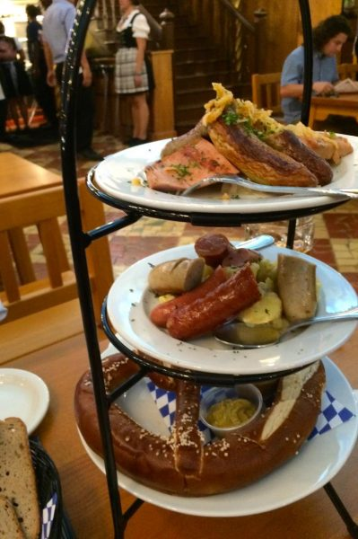 Sampling of the delicious sausages, pretzel with three mustards, german potato salad and sauerkraut at Hofbrauhaus St. Petersburg